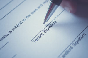 signing a lease agreement document