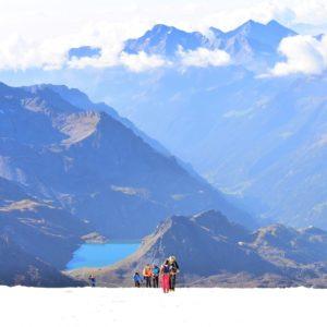 Mountain climbers reaching the summit