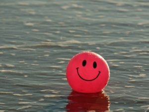 Red ball with smile denoting Happiness